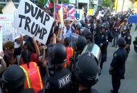 Anti-Trump demonstrators clash with police