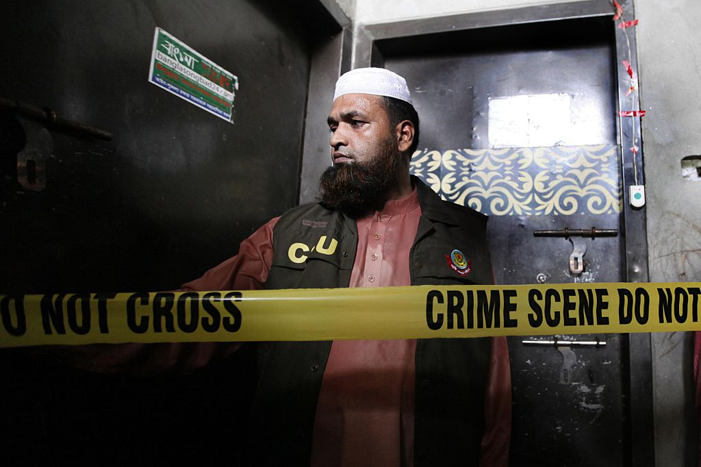 A policeman stand guards outside the home of murdered Bangladeshi blogger Niloy Chakrabarti, who used the pen-name Niloy Neel, in Dhaka on August 7, 2015.