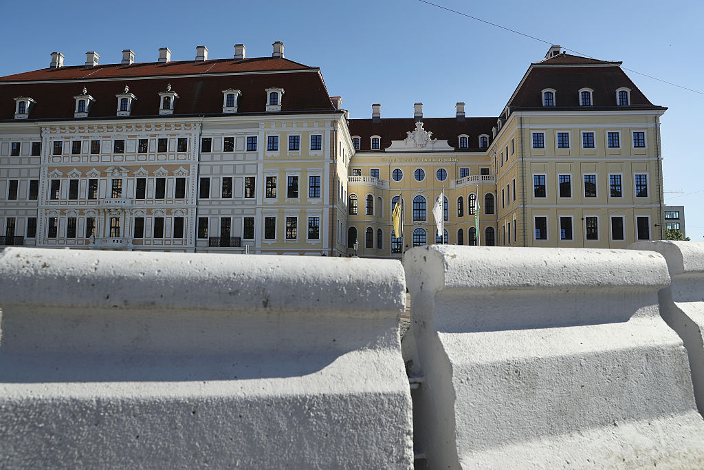 A low barricade erected earlier in the day stands outside the Hotel Taschenbergpalais Kempinski Dresden