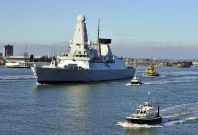 New British Royal Navy destroyer HMS Daring, the first of the Royal Navy\'s new Type 45 destroyers, leaves the southern English harbour of Portsmouth
