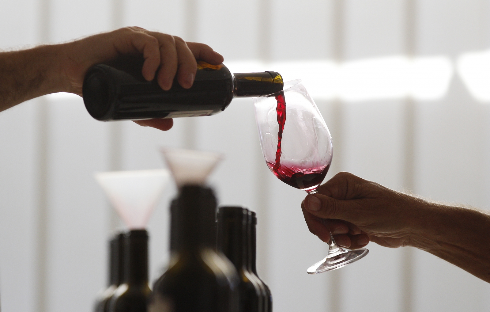 Red wine pouring