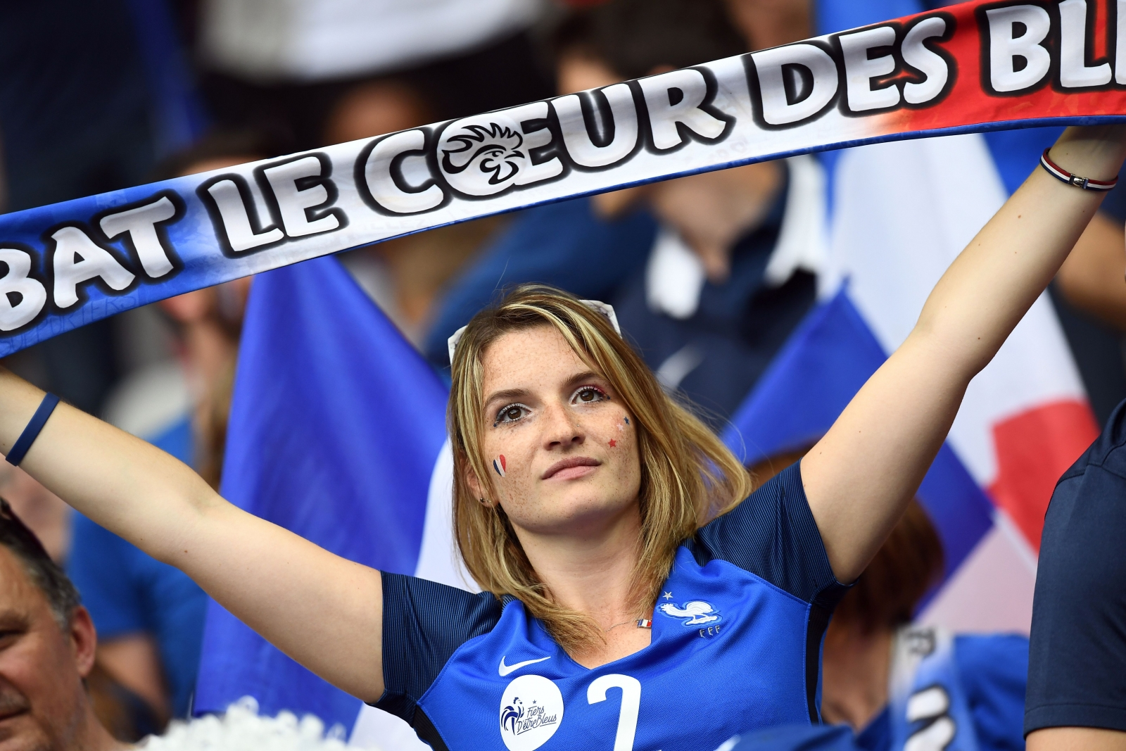 A French fan cheers her team on
