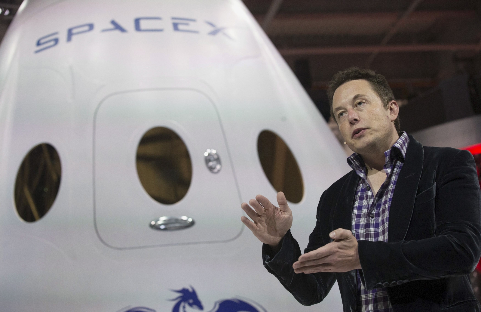 Elon Musk speaks at a SpaceX event