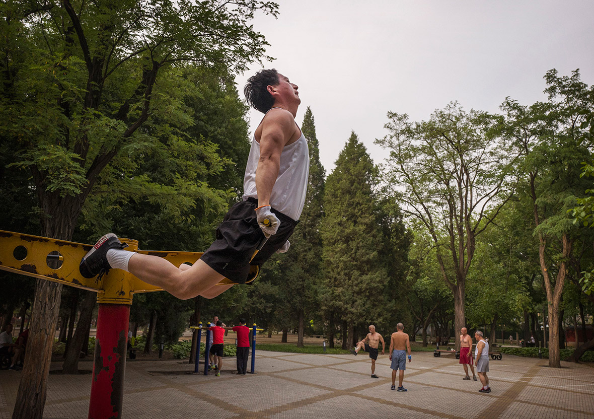 https://d.ibtimes.co.uk/en/full/1524596/ritan-park-beijing-kevin-frayer.jpg?w=1180&e=fa1f09bbb0ff1f3a37a8d789a0d7aad7