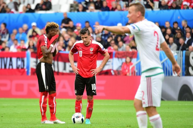 Alaba (left) lines up a freekick
