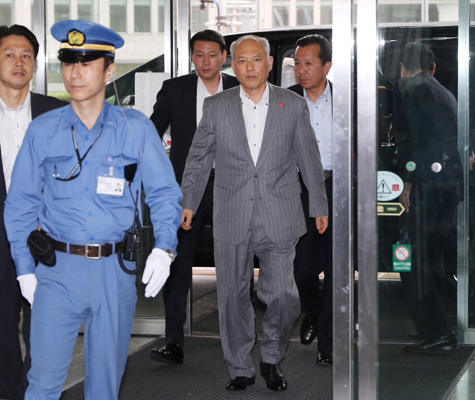 Japan governor arrives at government offices