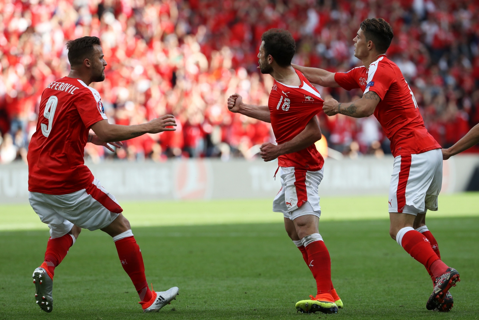 Swiss players celebrating their goal