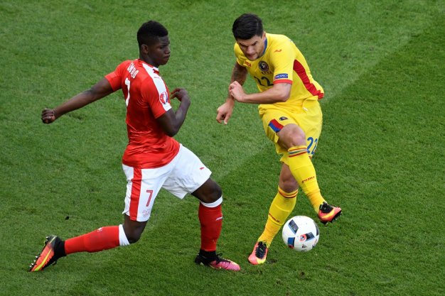 Embolo challenges for the ball