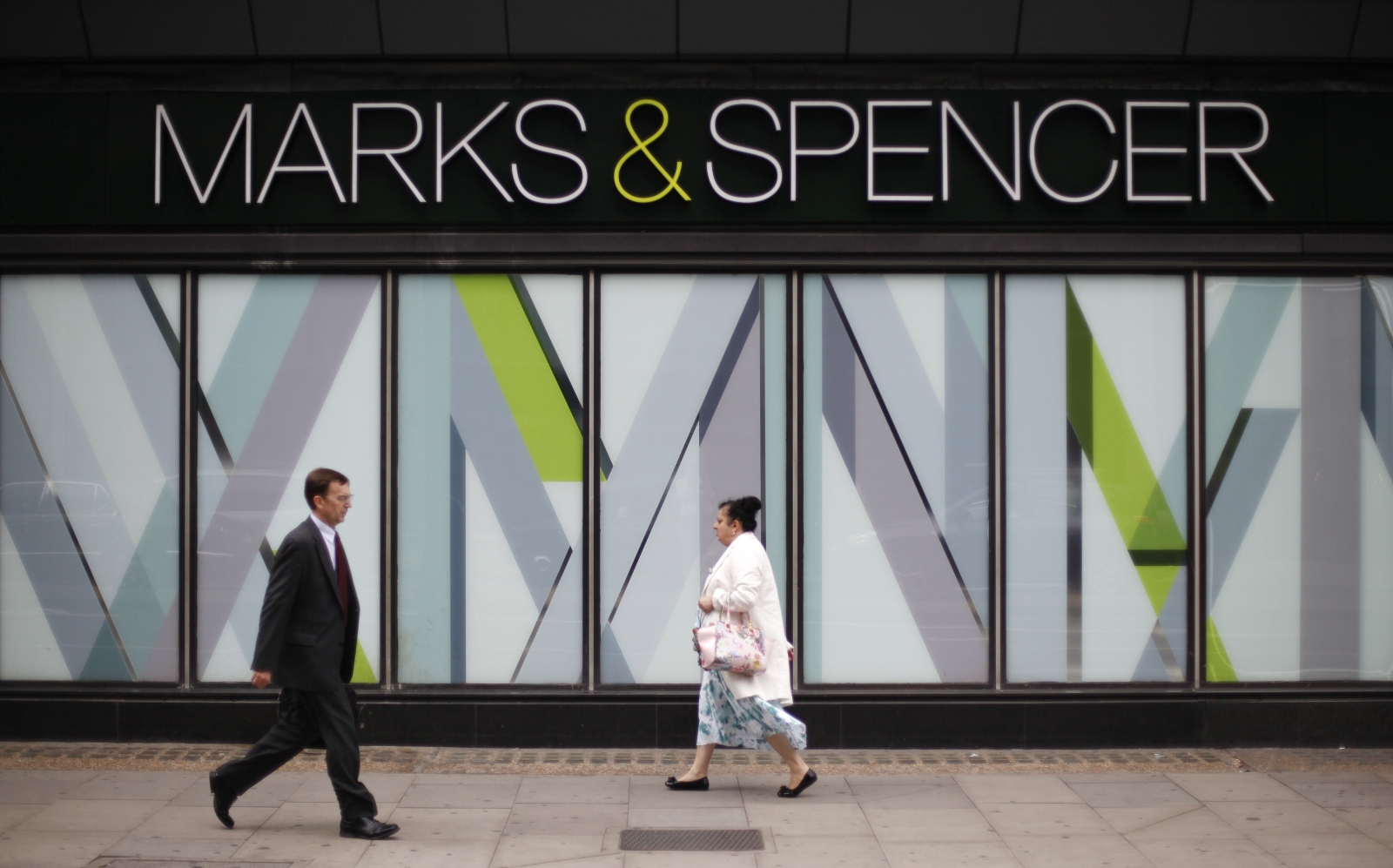Marks and Spencer criticised for cutting the pay of about 10% of its shop-floor workers