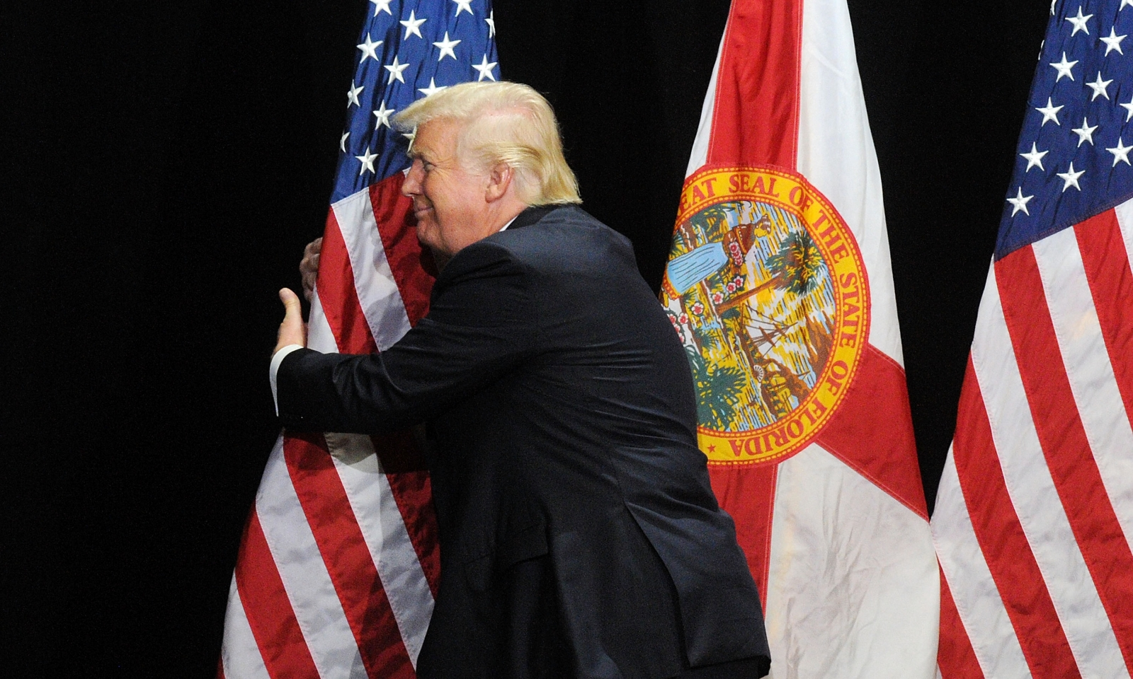 Donald Trump hugging a flag