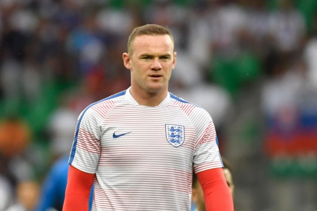 Wayne Rooney prepares for the game
