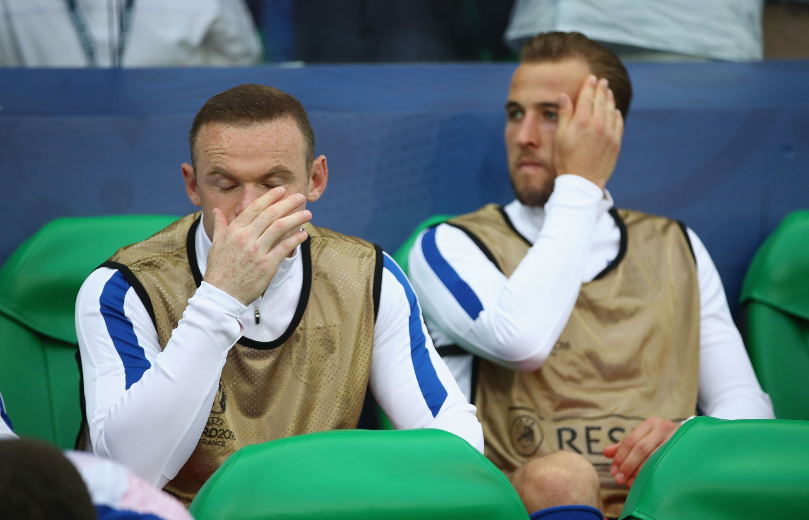 Wayne Rooney and Harry Kane watch on