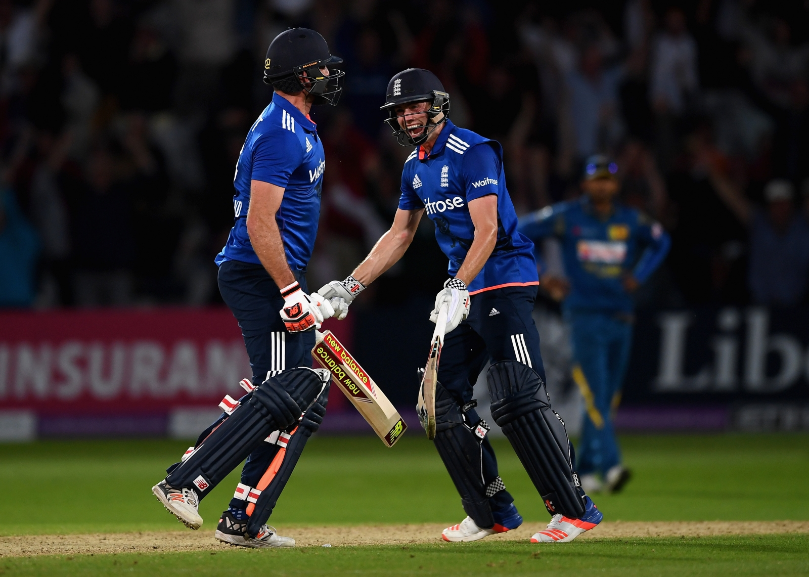 Liam Plunkett and Chris Woakes celebrate