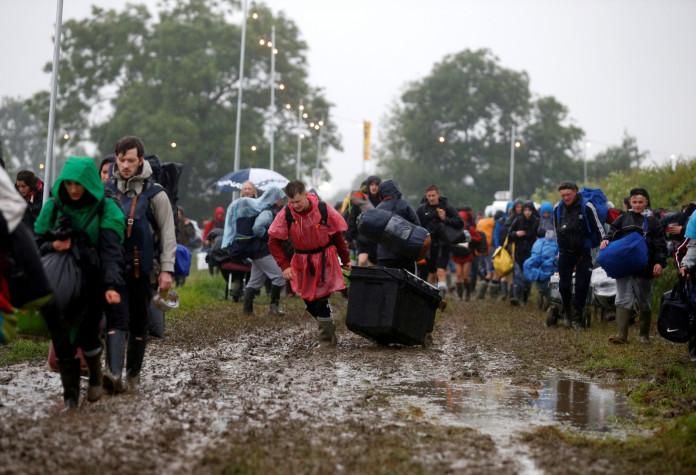 Muddy festival goers at Glastonbury 2016