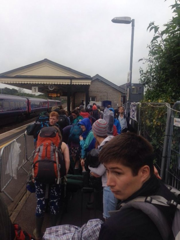 Glastonbury goers queue at Castle Cary