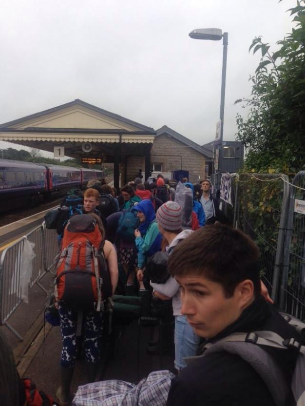 Glastonbury goers queue at Castle Cary
