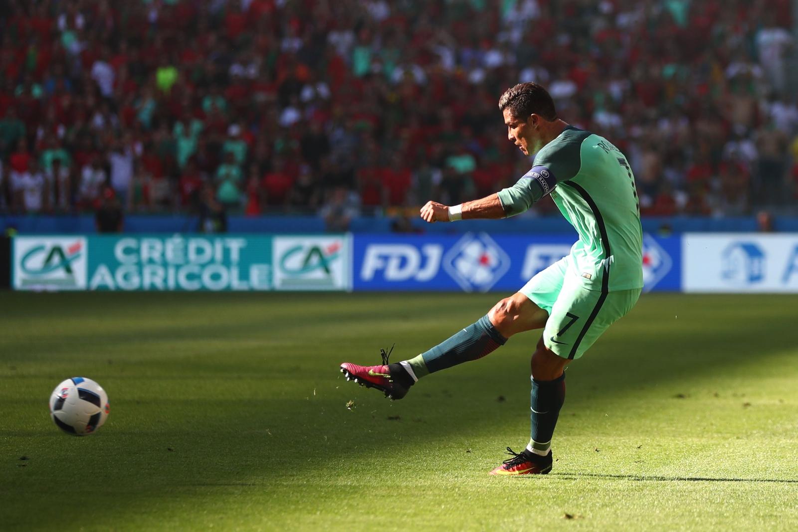 Cristiano Ronaldo hits a shot