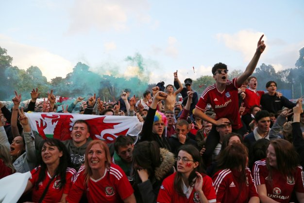Welsh fans watch the game