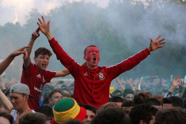 Welsh fans cheer their team