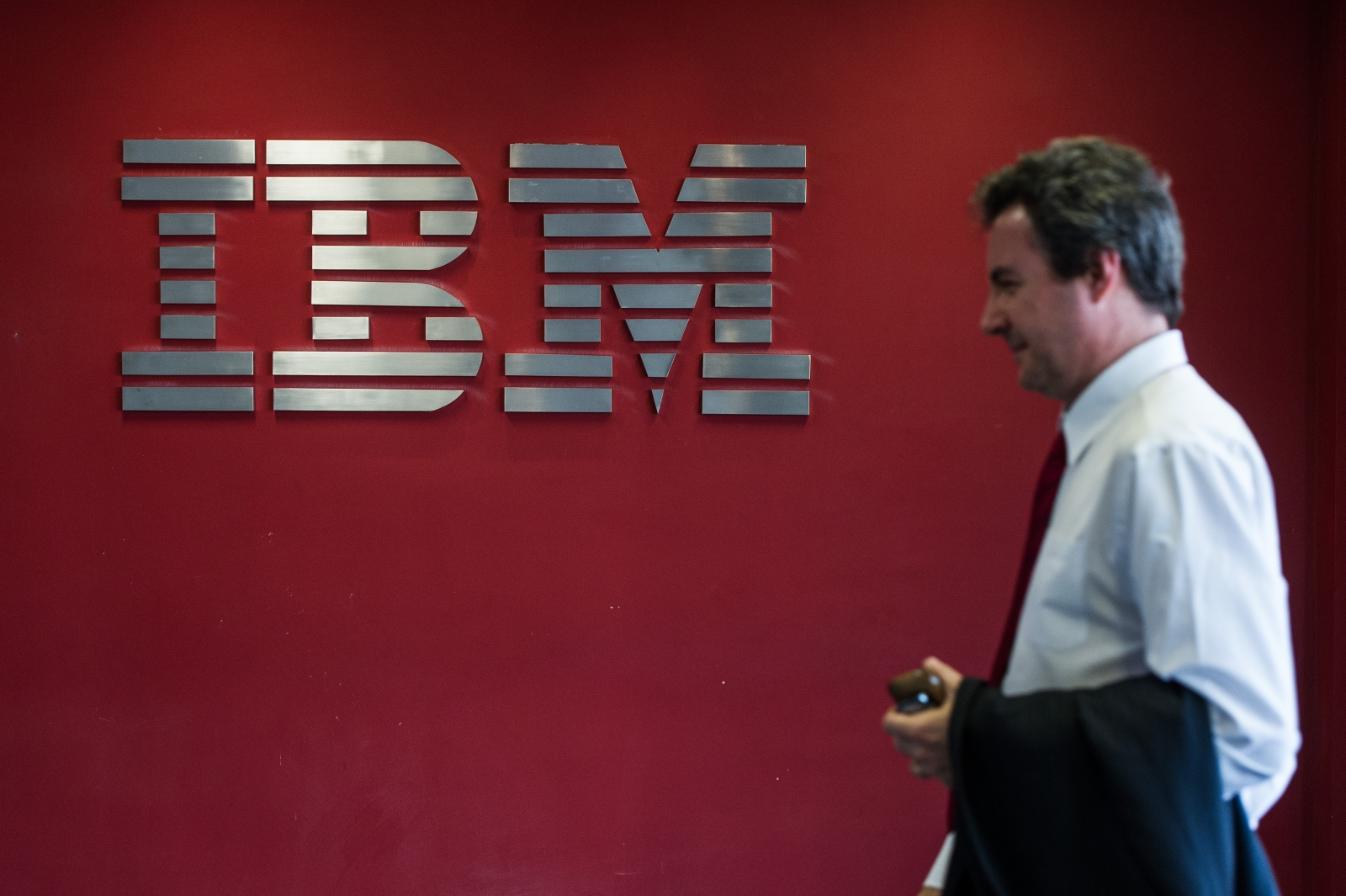 IBM logo and staffer
