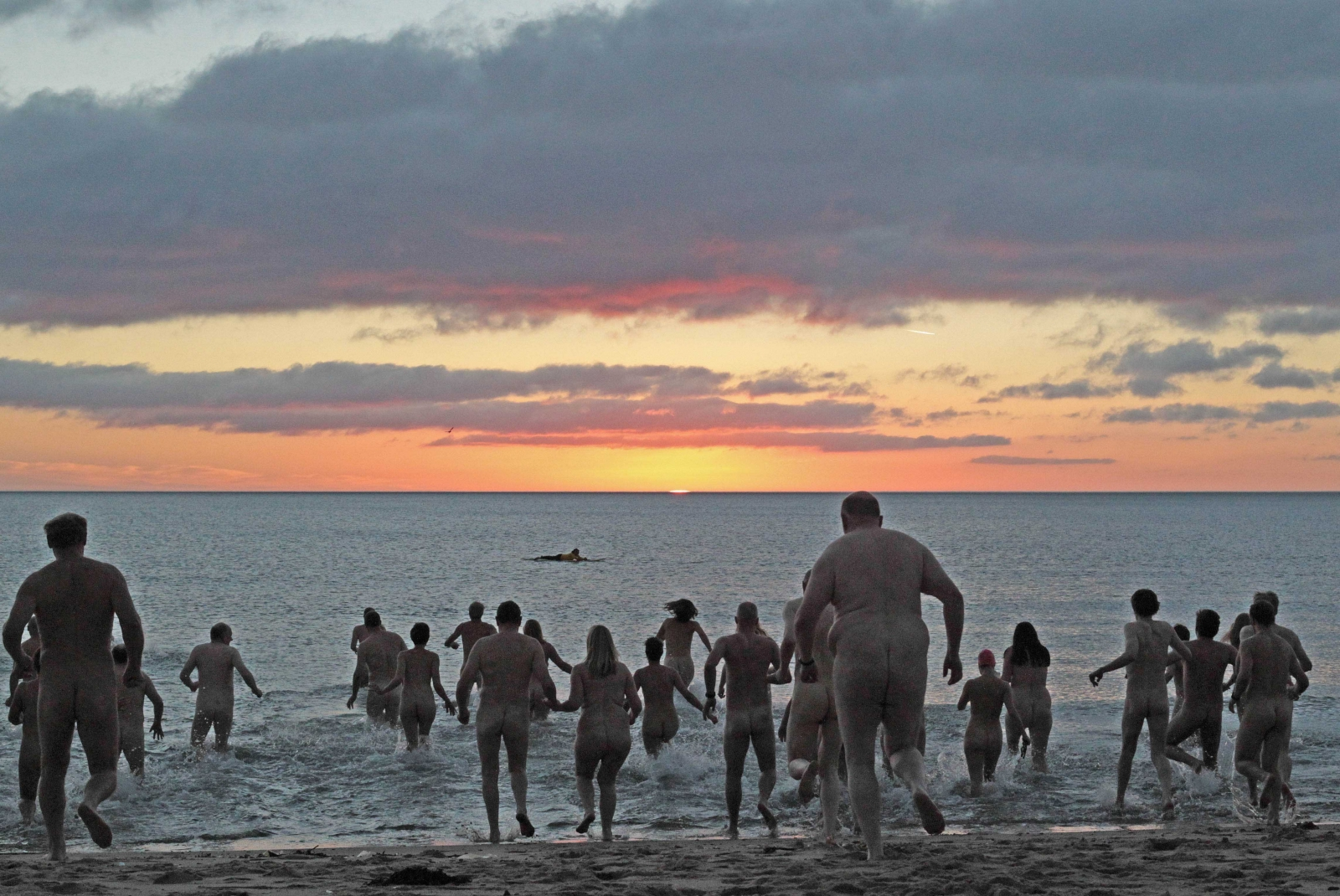 Naturists attend an annual skinny dip