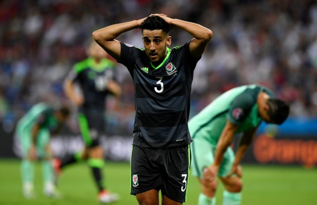 Neil Taylor looks down
