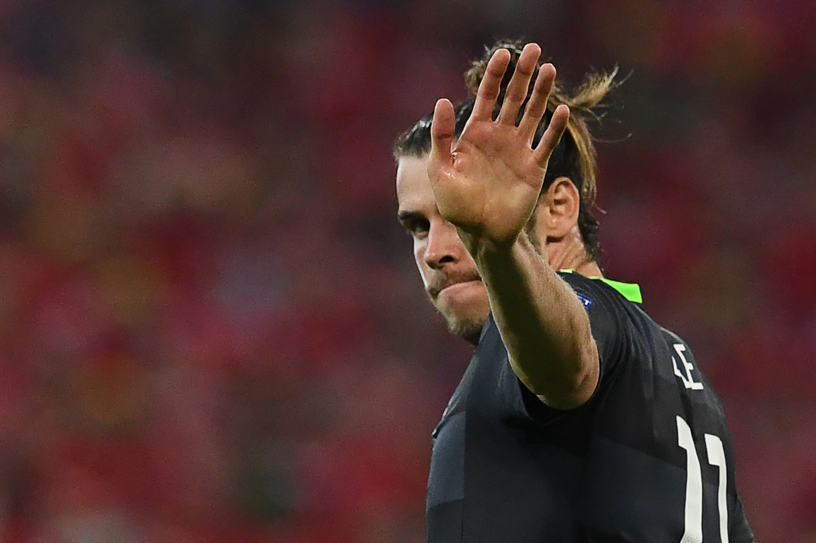 Gareth Bale waves goodbye to Welsh fans