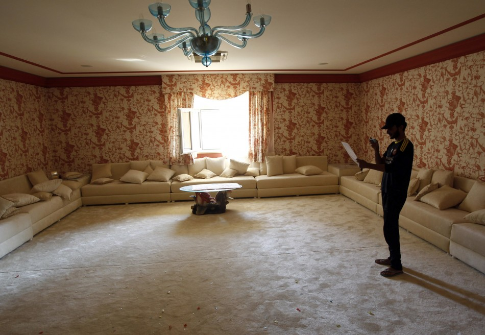 A man stands inside the house of Aisha, the daughter of Libyan leader Moammar Gadhafi in Tripoli August 26, 2011. REUTERS/Goran Tomasevic