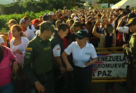 Thousands of Venezuelans cross temporary open border to buy food and medicine