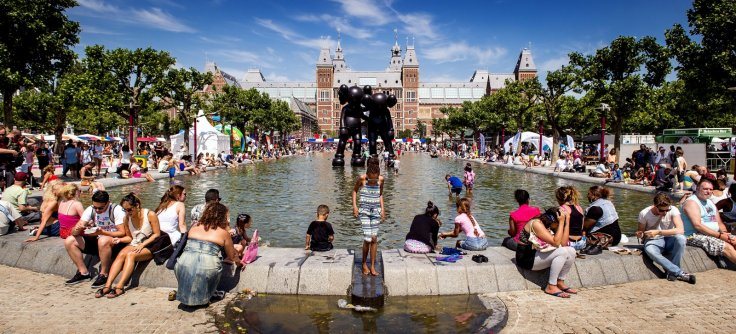 People in Amsterdam cool off in fountain