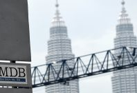 """1MDB: Singapore's central bank to take """"firm regulatory actions"""" against Standard Chartered, UBS and DBS Bank"""