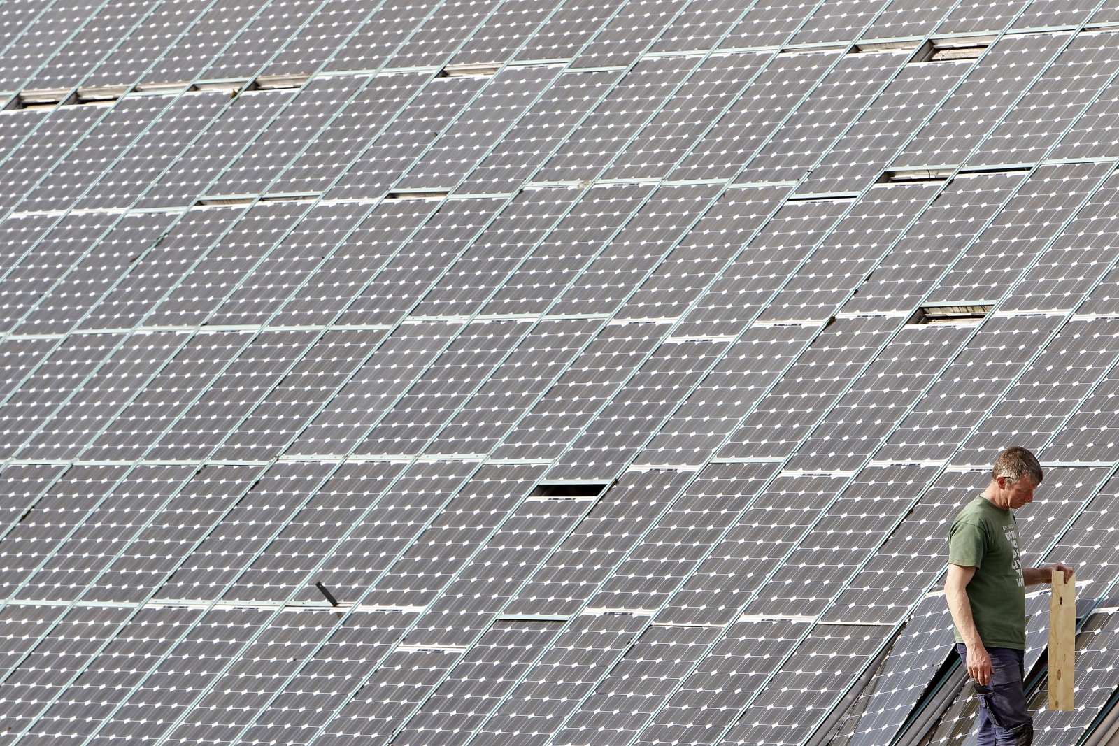 A man works on solar panels
