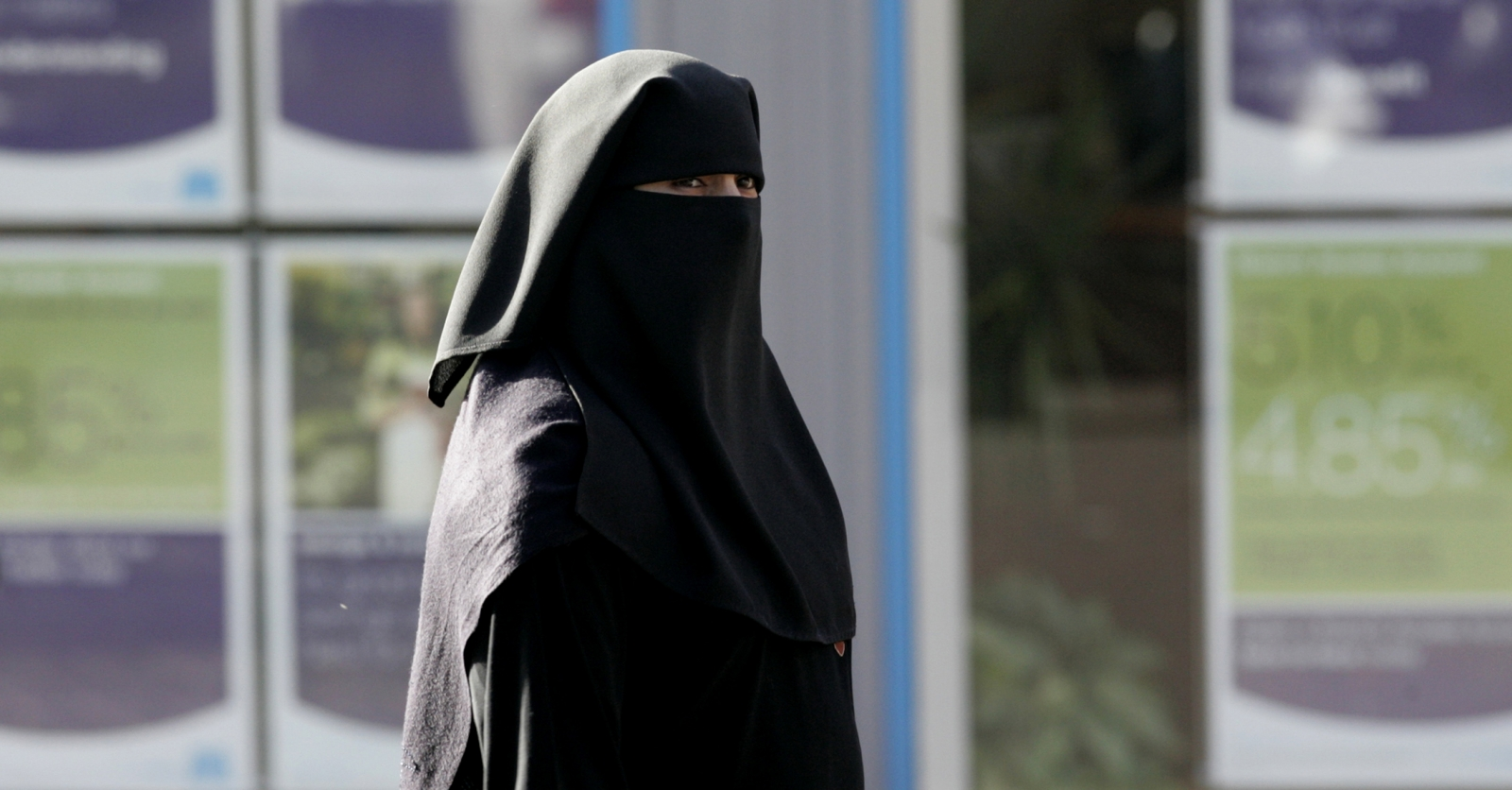A Muslim woman wearing a niqab in