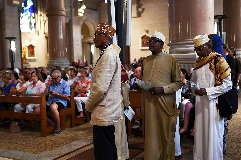 Muslims of the Comorian community attend a Mass at the Sacre Coeur basilica in Marseille in tribute to the priest Jacques Hamel, killed on July 26