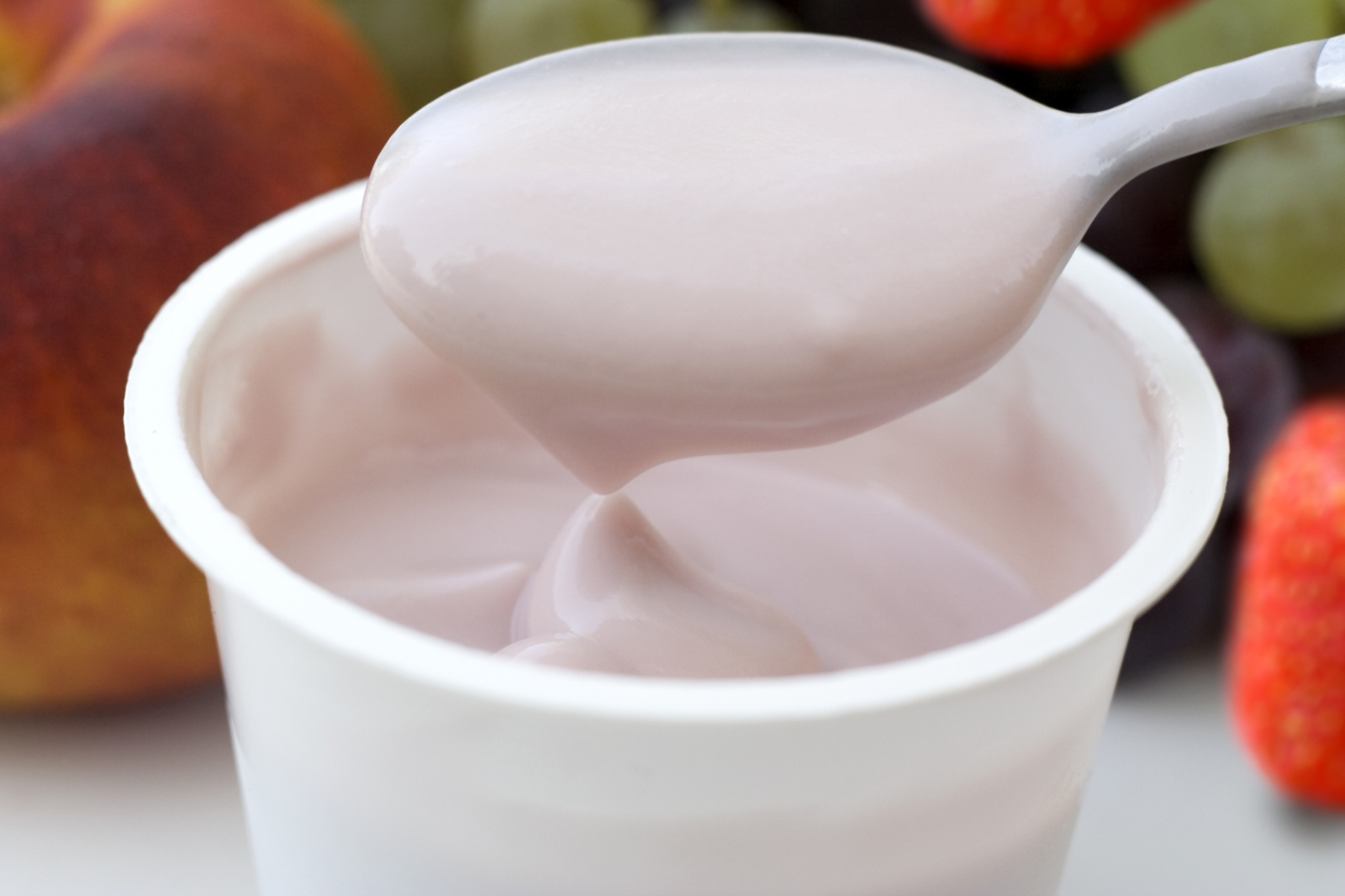 Fruit yoghurt with spoon
