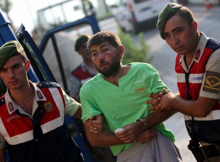Turkish gendarmeries escort one of the 11 fugitive commandos