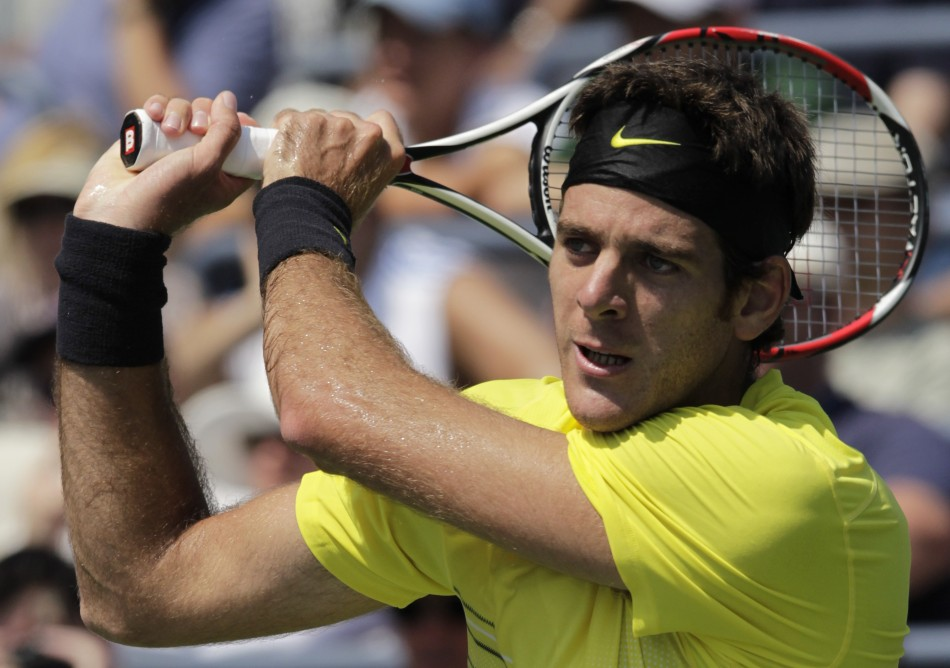 Juan Martin Del Potro of Argentina hits a return to compatriot Diego Junqueira during their match at the U.S. Open tennis tournament in New York