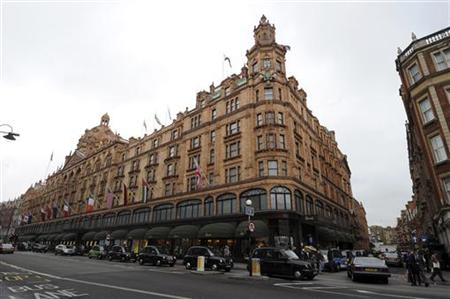 Traffic passes the Harrods department store in London