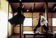 """Actor Keanu Reeves (L) and Collin Chou are shown in a scene from the new futuristic action thriller film""""The Matrix Reloaded,"""" also starring Laurence Fishburne and Carrie-Anne Moss in this undated publicity photograph."""