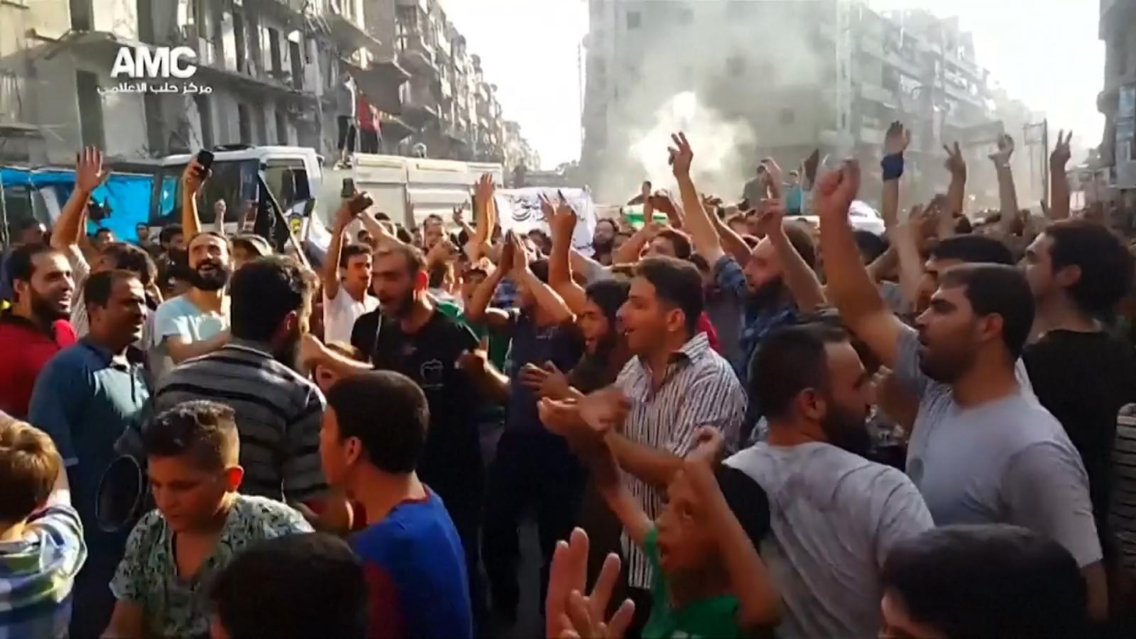 Syrian celebrating
