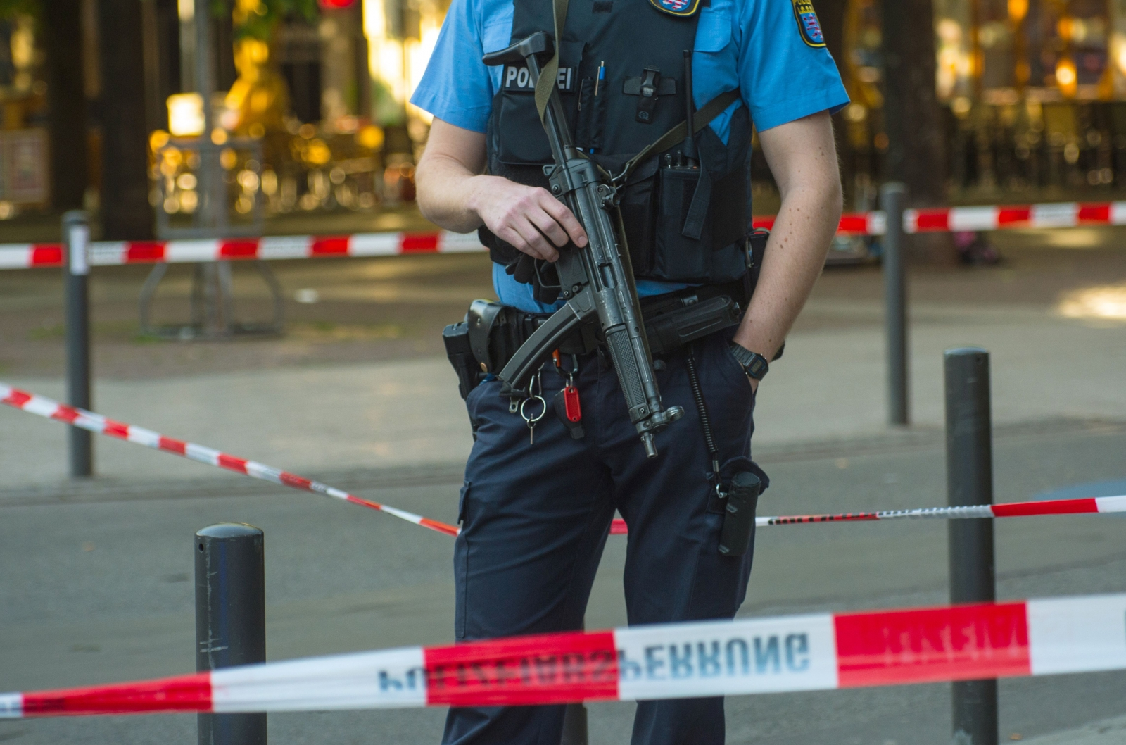 File Photo:An armed policeman is seen behind a barrier tape at the site of a shooting in the centre of Frankfurt am Main