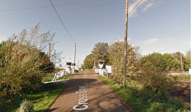 Car hit by train on level crossing