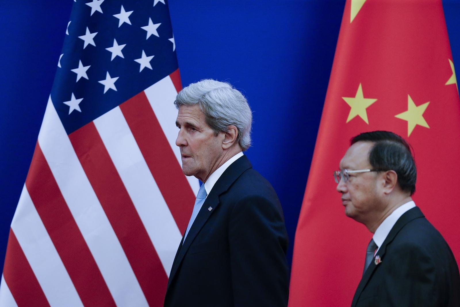 John Kerry and  Yang Jiechi