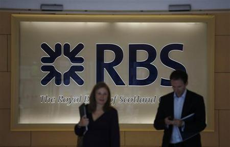 Two people walk out of the headquarters of the Royal Bank of Scotland in the City of London