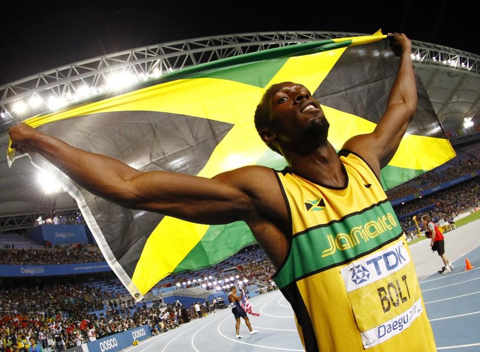 Usain Bolt of Jamaica celebrates winning the men's 200 metres final at the IAAF World Athletics Championships in Daegu
