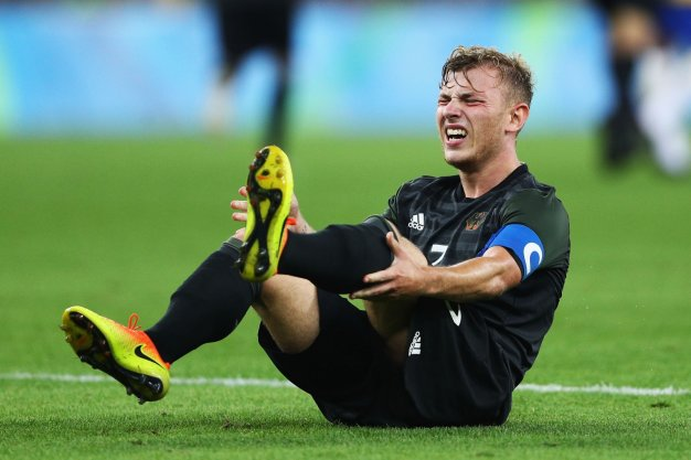 Max Meyer goes down with cramp