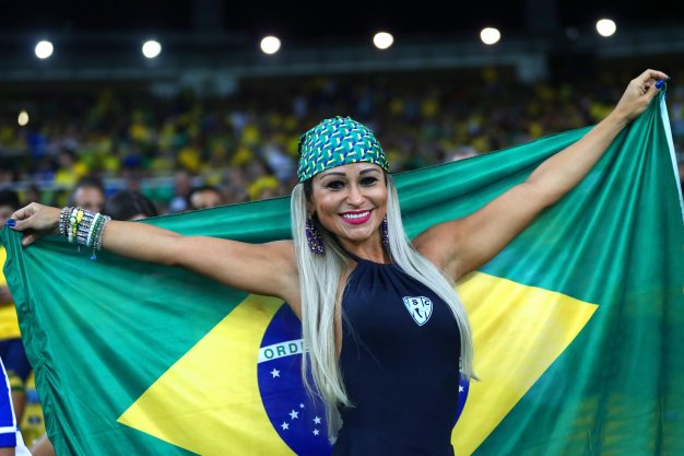 A Brazil fan watches the game