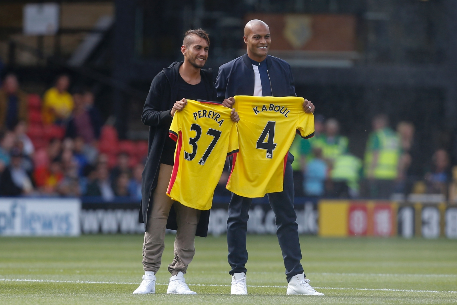 Roberto Pereyra and Younes Kaboul