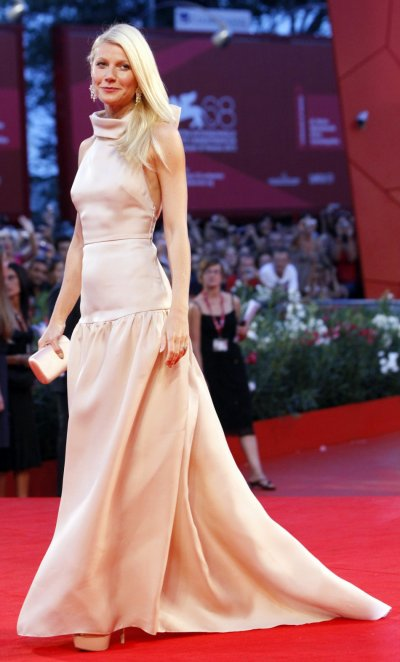 Actress Gwyneth Paltrow poses for photographers as she arrives on the quotContagionquot red carpet at the 68th Venice Film Festival