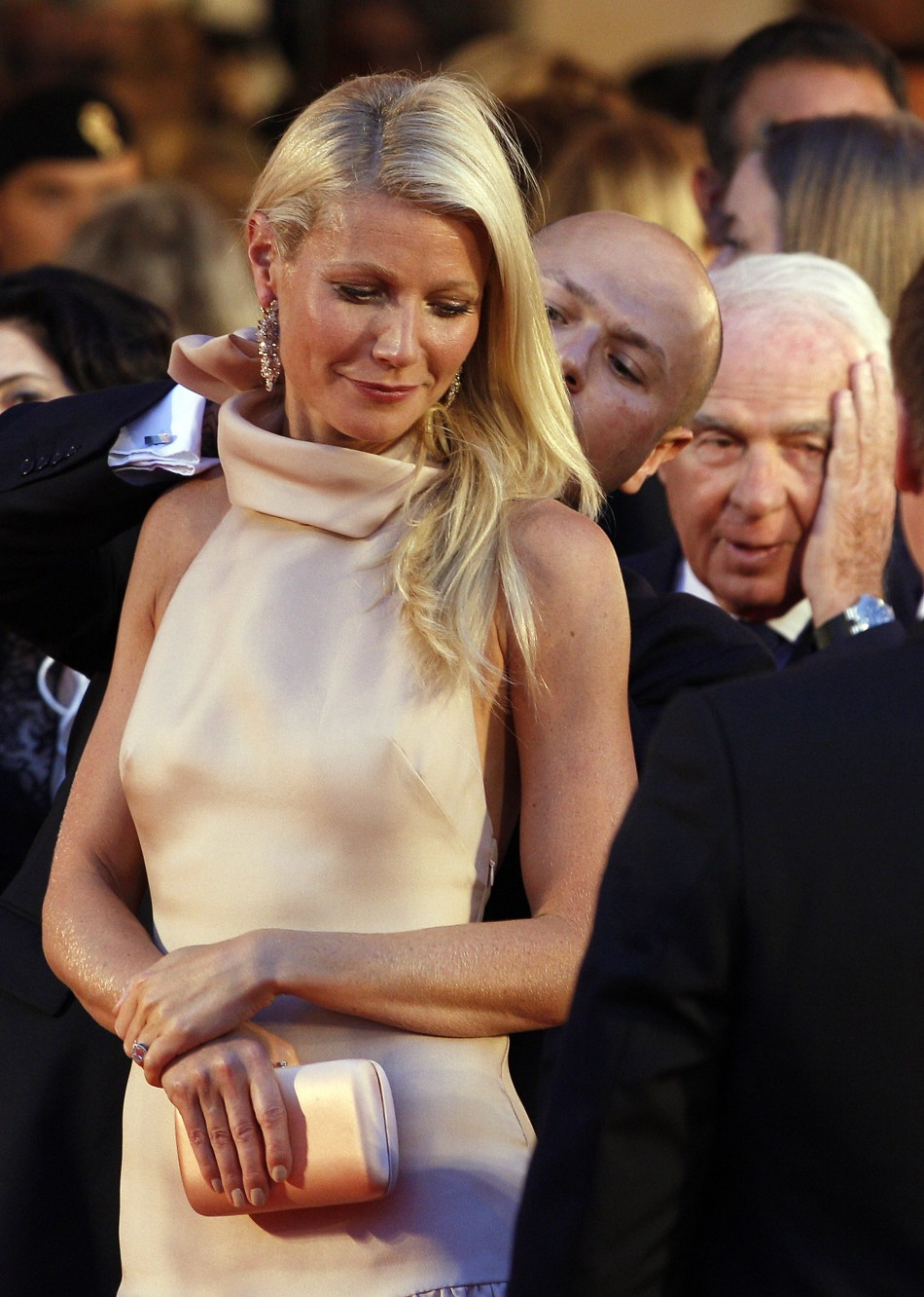 Actress Paltrow, cast member of movie quotContagionquot, is helped by assistant as she arrives on red carpet at Cinema Palace during 68th Venice Film Festival
